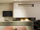 Камин в интерьере квартиры: украшение или важный элемент жилища
